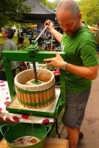 David Young with the apple press at Queens Park Day 2011